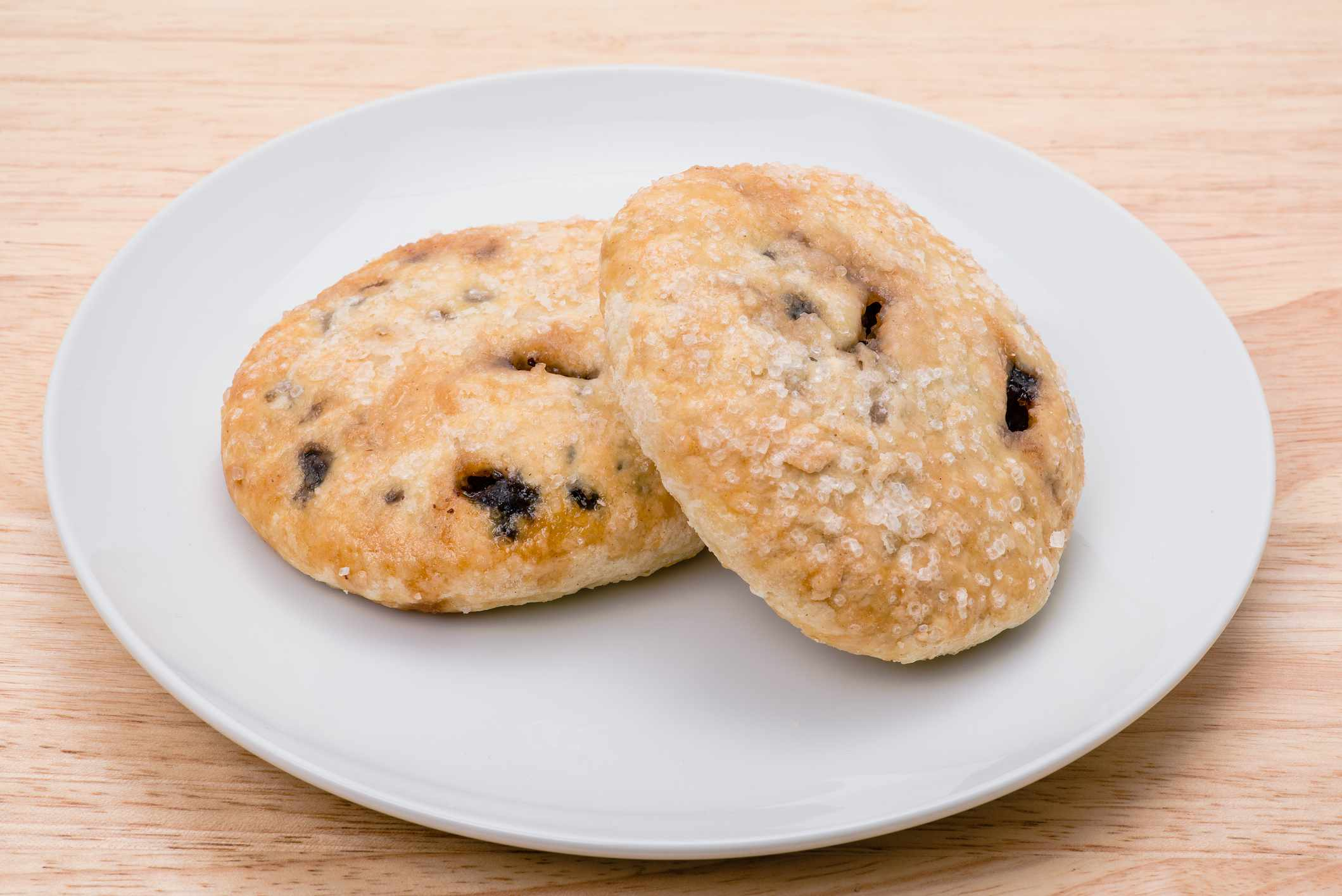 two whole eccles cakes on a white plate