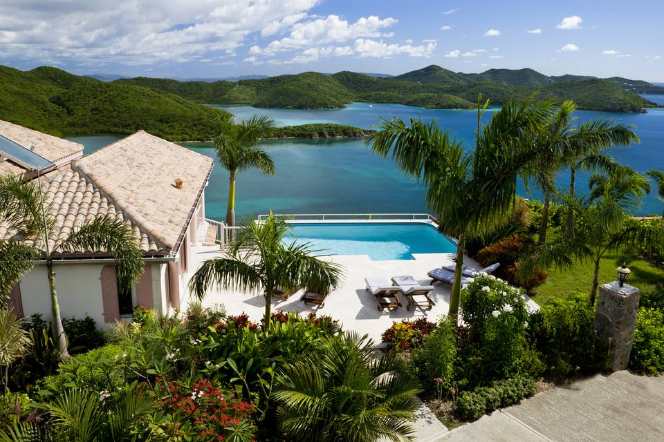 View of a villa with pool overlooking blue waters of the Virgin Islands