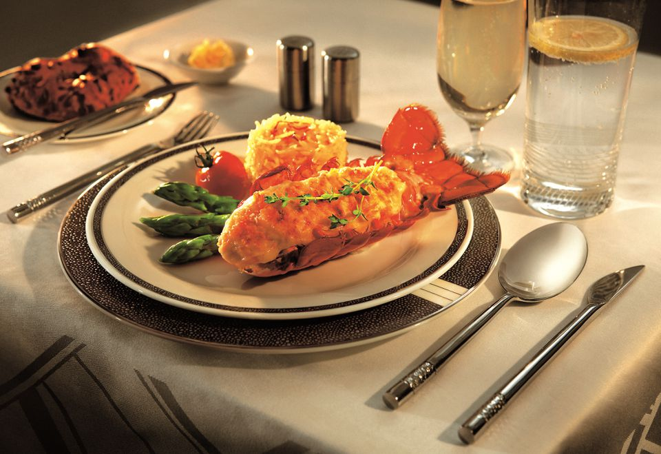 Singapore Airlines first class meal of lobster thermidor on fine china dinneware