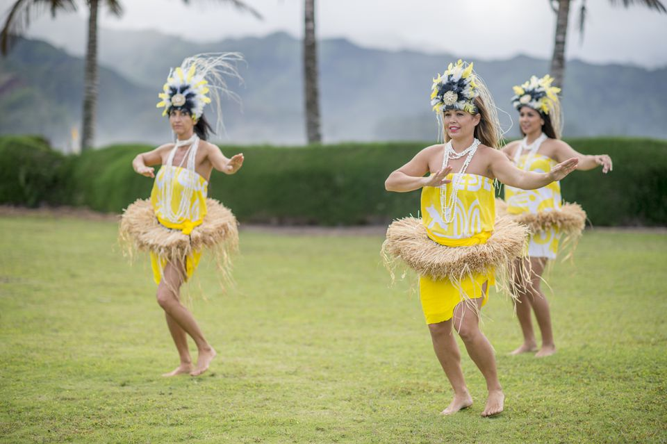 Women Happily Performing at a Luau