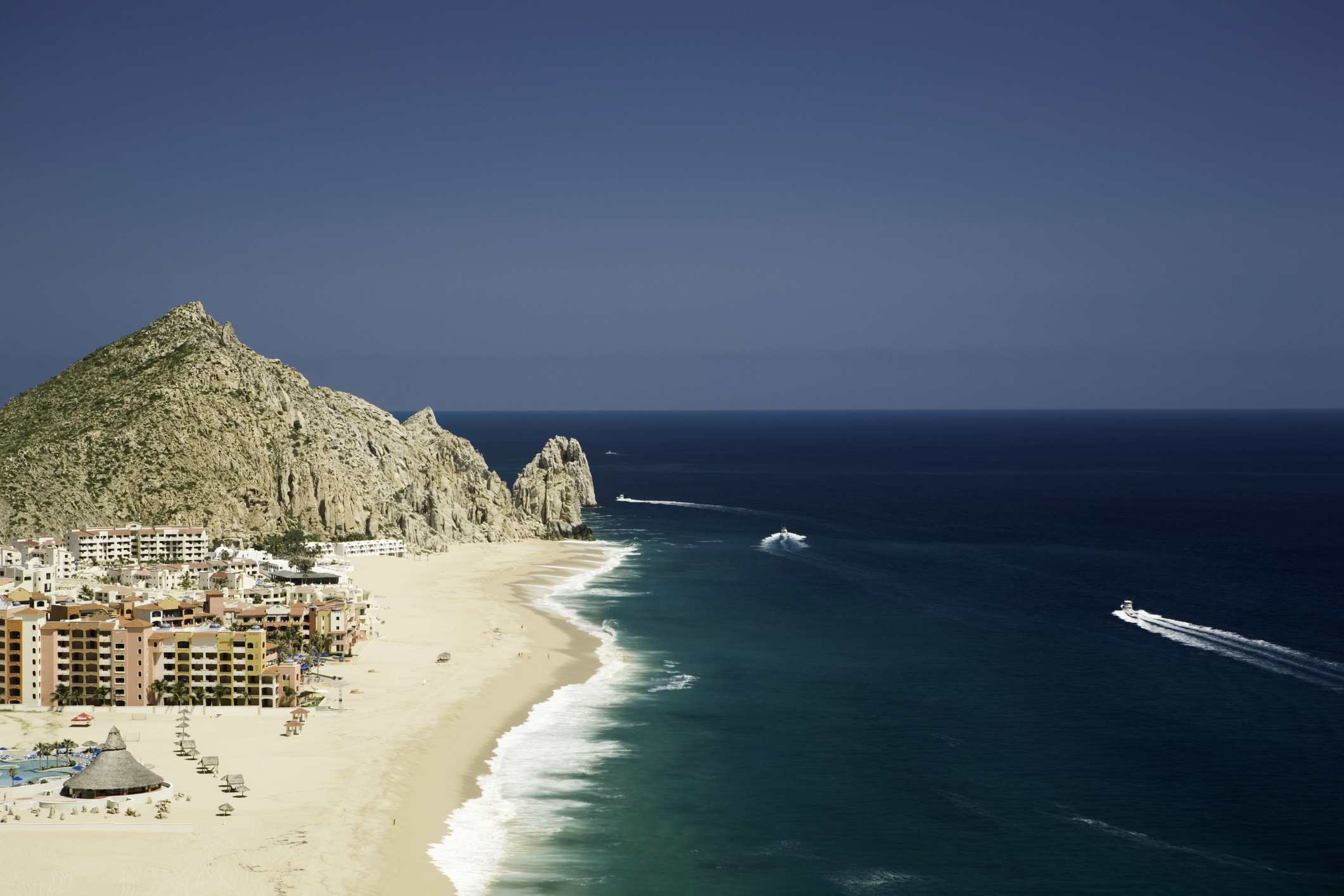 An elevated view of Mexico, Baja, Cabo San Lucas, resorts on beach