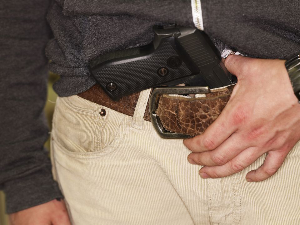 Young man with gun in belt