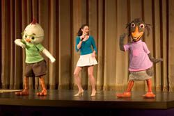Disney characters on stage at El Capitan