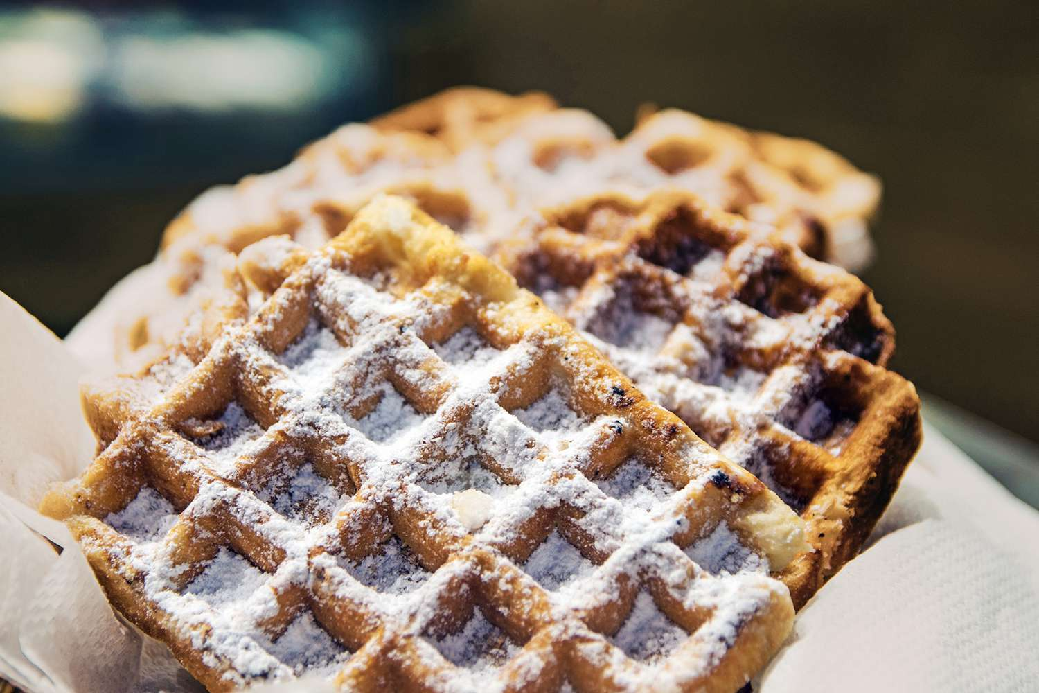 A delicious close up of a Belgian Waffle, Brussels style with only powdered sugar on top