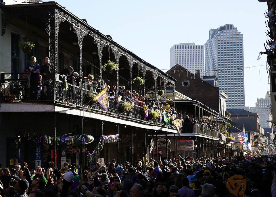 Revelers pack Bourbon Street during Mardi Gras.