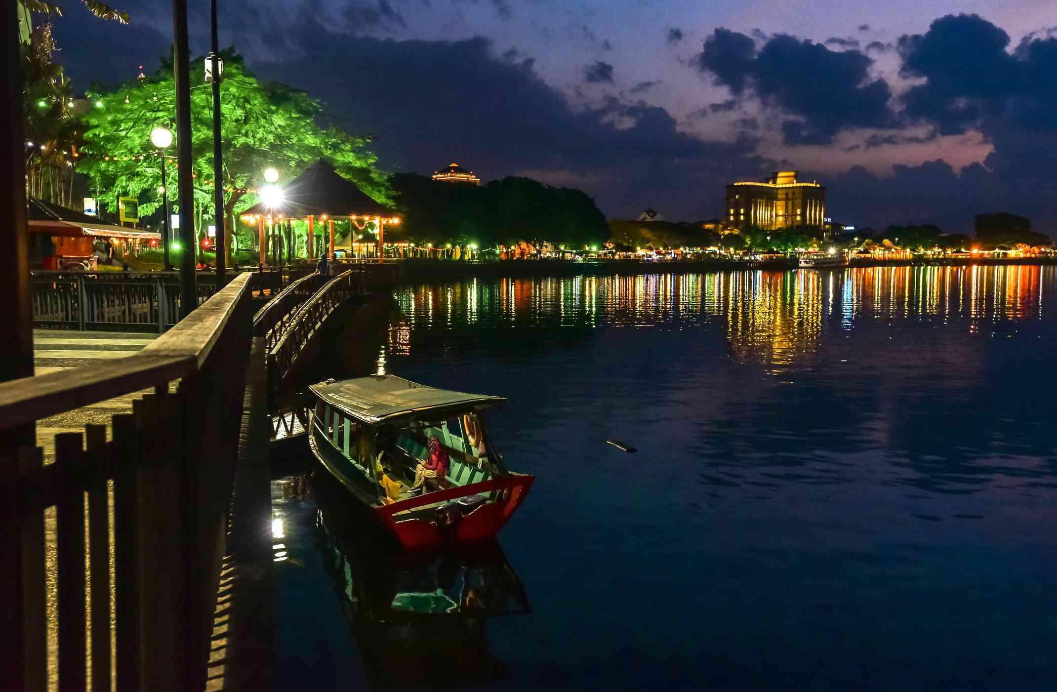 Water Taxi at dusk at the Kuching City Waterfront, Malaysia
