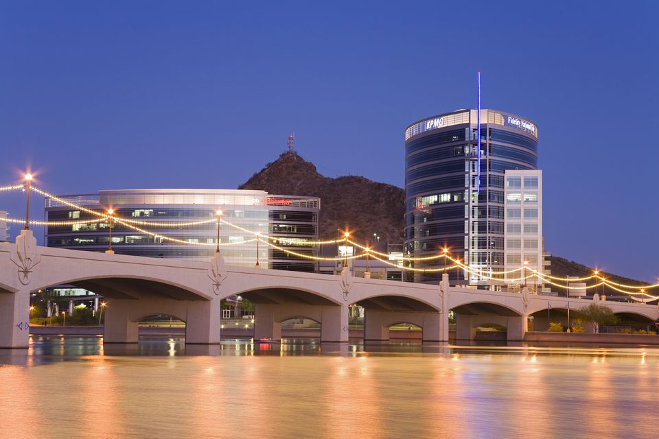 Town Lake and Mill Avenue Bridge illuminated at dusk, Tempe, Arizona