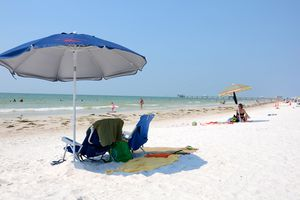 Umbrella and beach chairs on the white sands of Clearwater Beach.