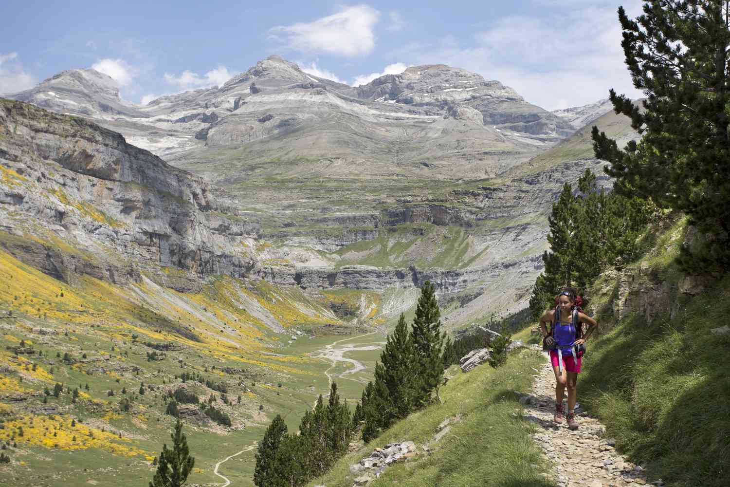 Woman Hiking in the Pyrenees Mountains, Spain