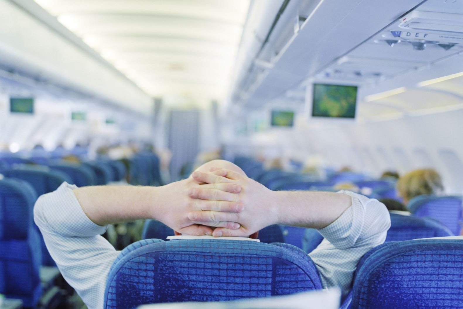 Passenger relaxing on airplane