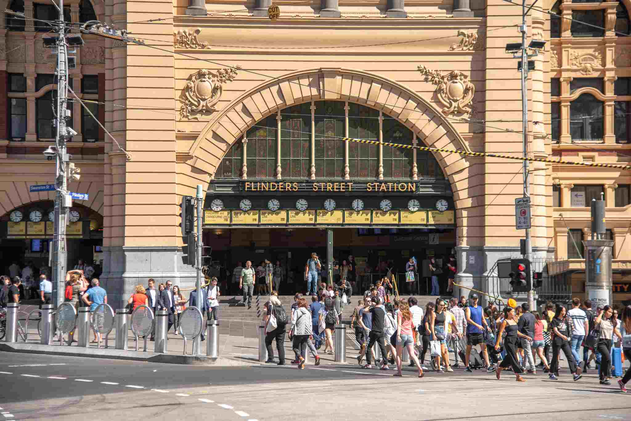 A large group of people in front of Flinders St Station