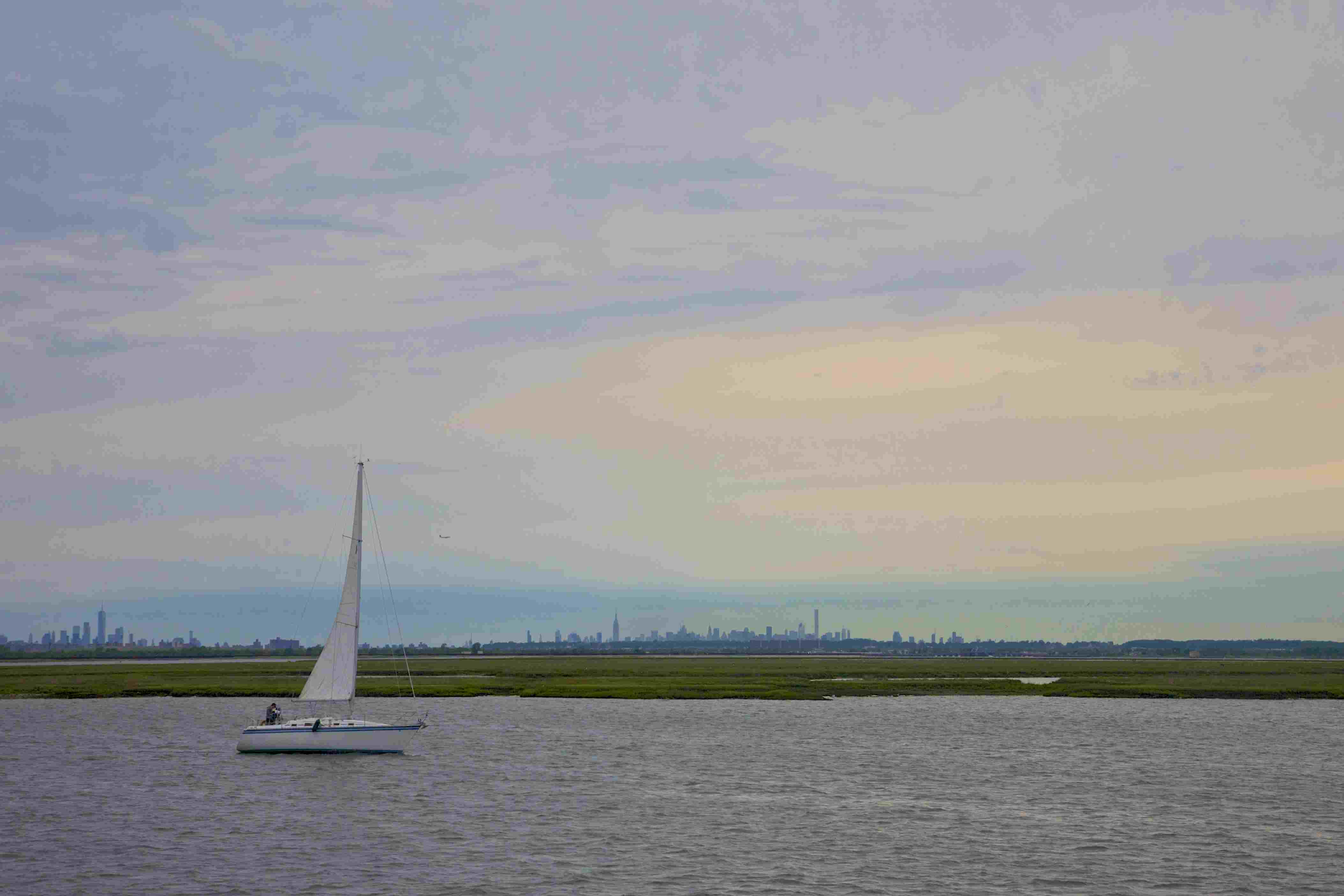 Sailboat near marsh on Jamaica Bay, Queens