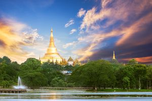 Shwedagon pagoda scenic view from the Bogyoke park in the center of Yangon Myanmar with wonderful sky in sunset time, twilight