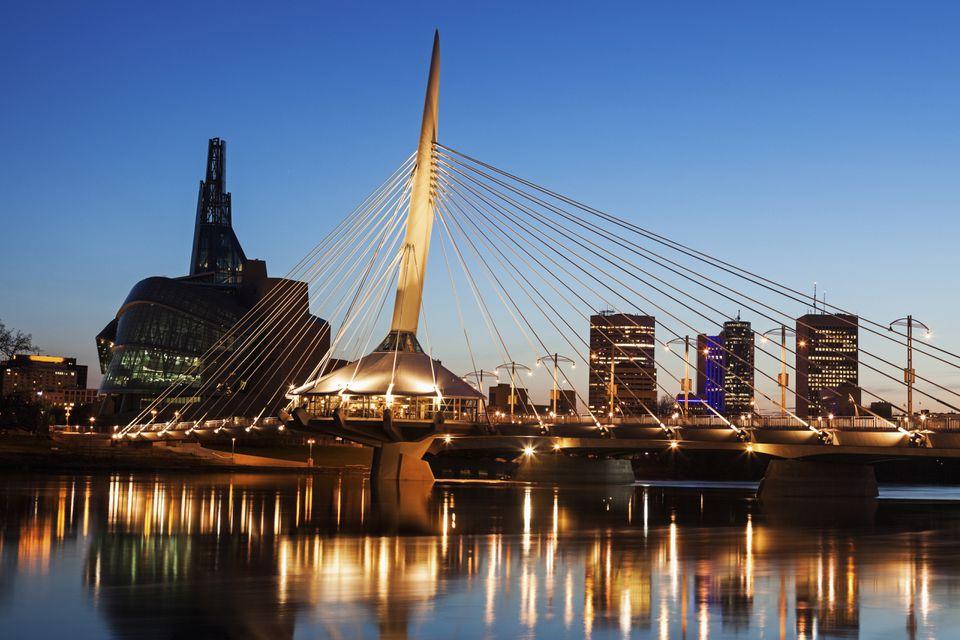 Canada, Manitoba, Winnipeg, Canadian Museum for Human Rights and Esplanade Riel bridge at dusk