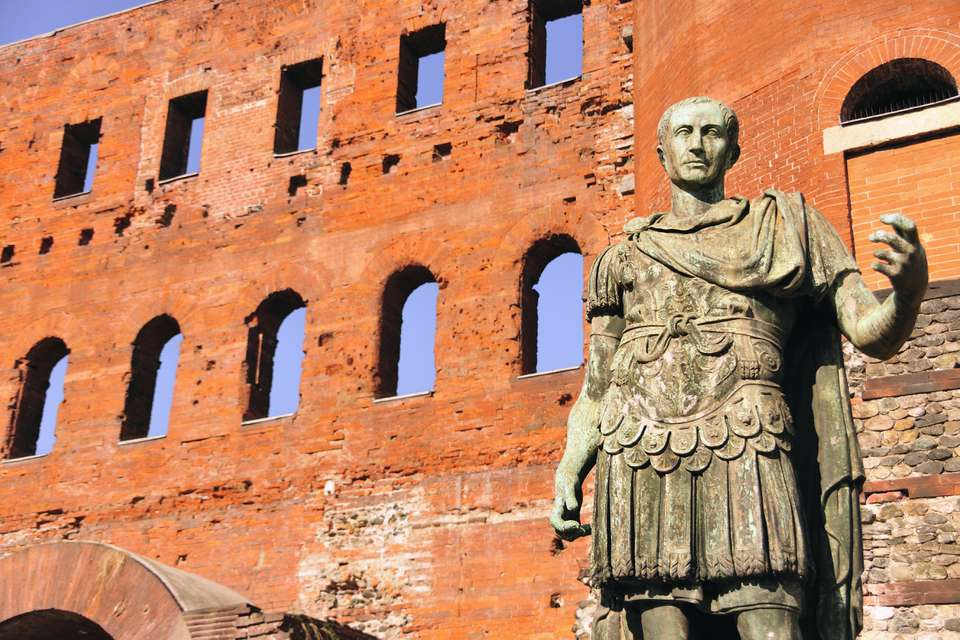 Ancient Roman bronze statue of Emperor Augustus, Porte Palatine city gate, Turin, Piedmont, Italy