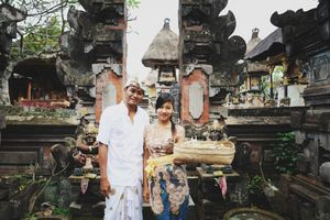 Balinese posing in front of family temple