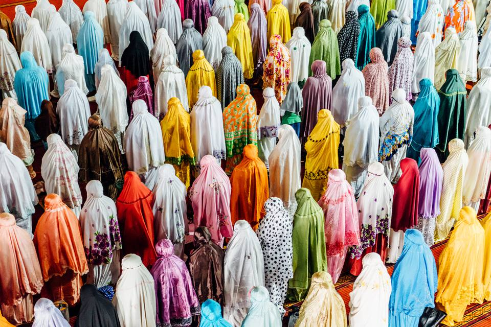 Muslim women in colorful burkas during Ramdan in Asia