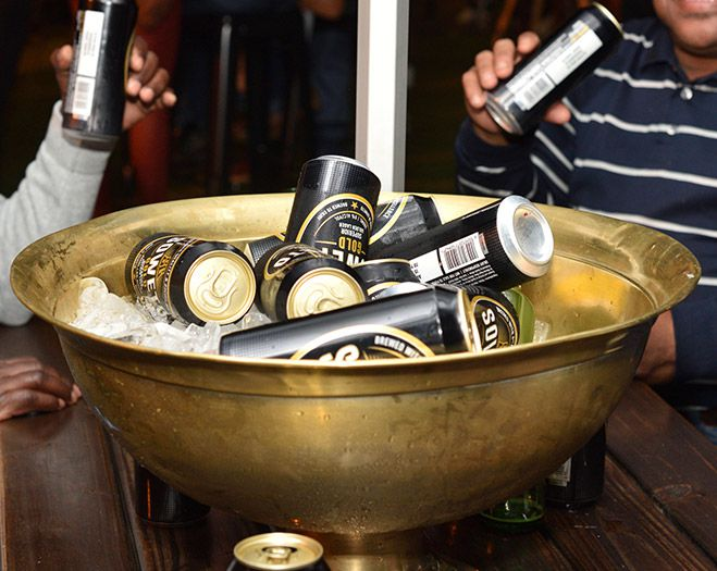 Gold metal gold filled with ice and soweto gold beer cans