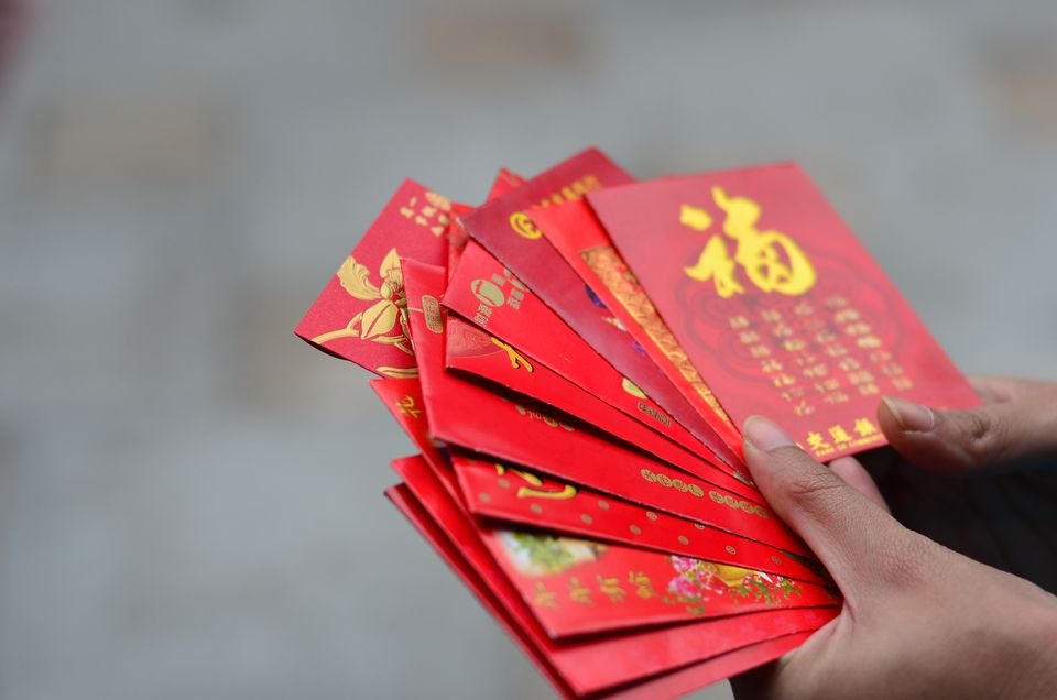 giving money in red envelopes