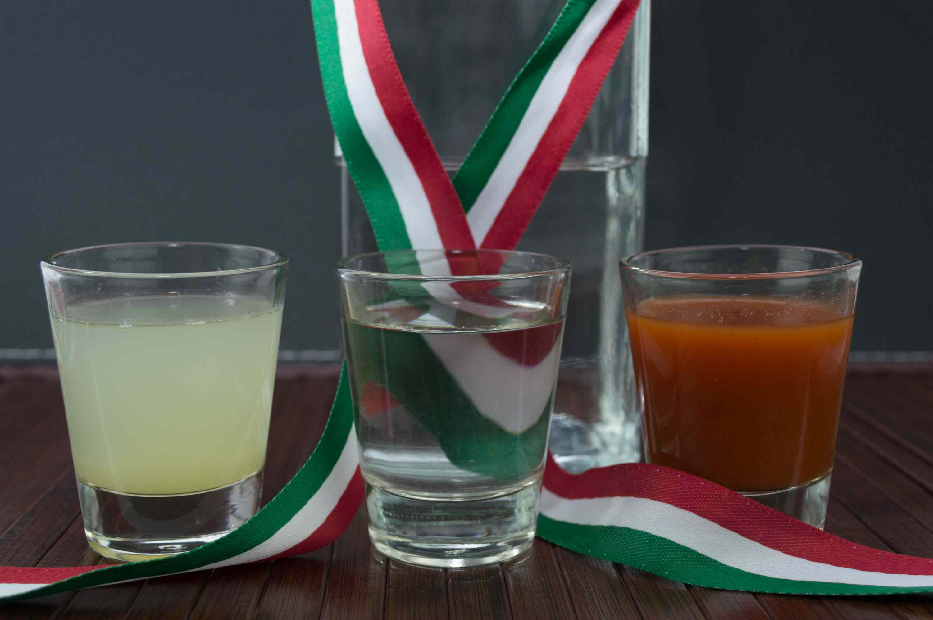 Mexican flag shots: lime juice, tequila and sangrita