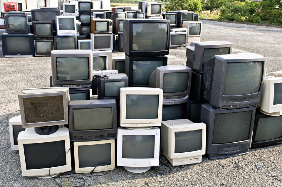 Television sets lined up to be recycled.