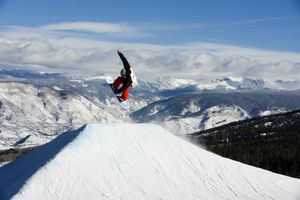 Snowboarder in terrain park