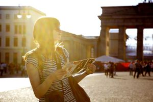 traveler in europe with guidebook