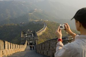 A tourist snaps a photo of the Great Wall of China at Mutianyu, near Beijing.