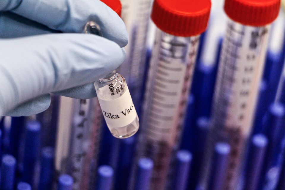 SEARCH Cropped Image Of Biologist Holding Zika Vaccine At Laboratory