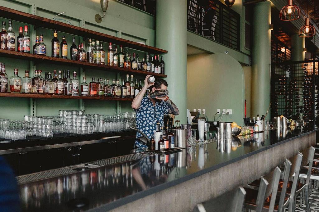 A bartender shaking a cocktail at Bar Solita