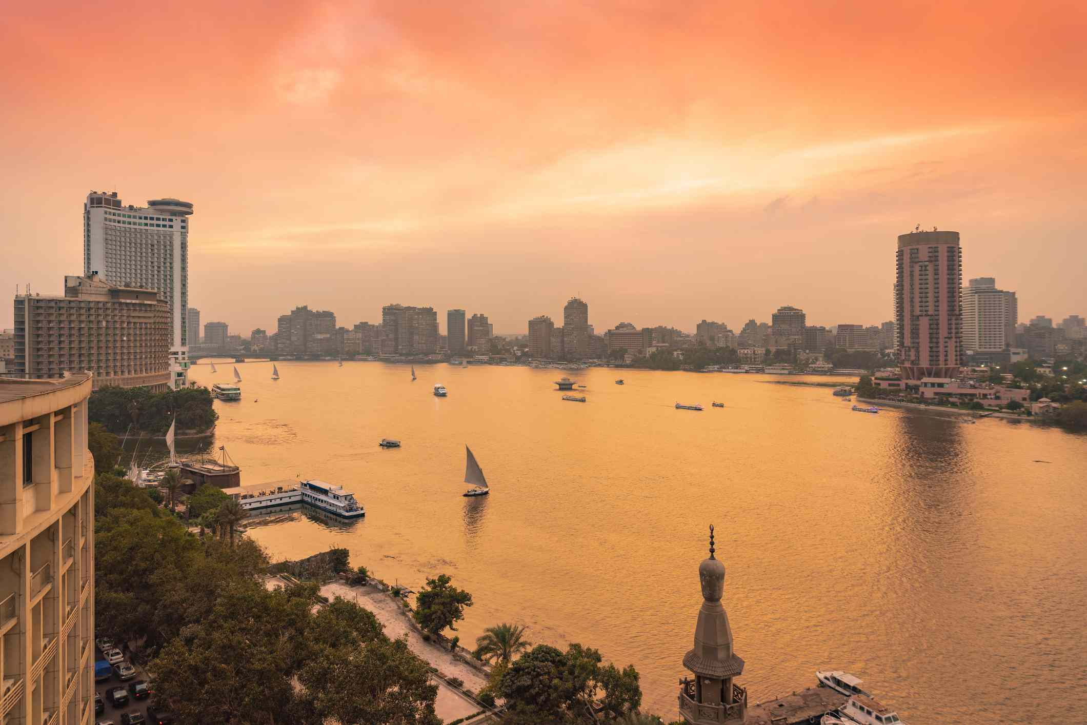 Egypt, Cairo, Nile with skyline and downtown area from Garden City at sunset