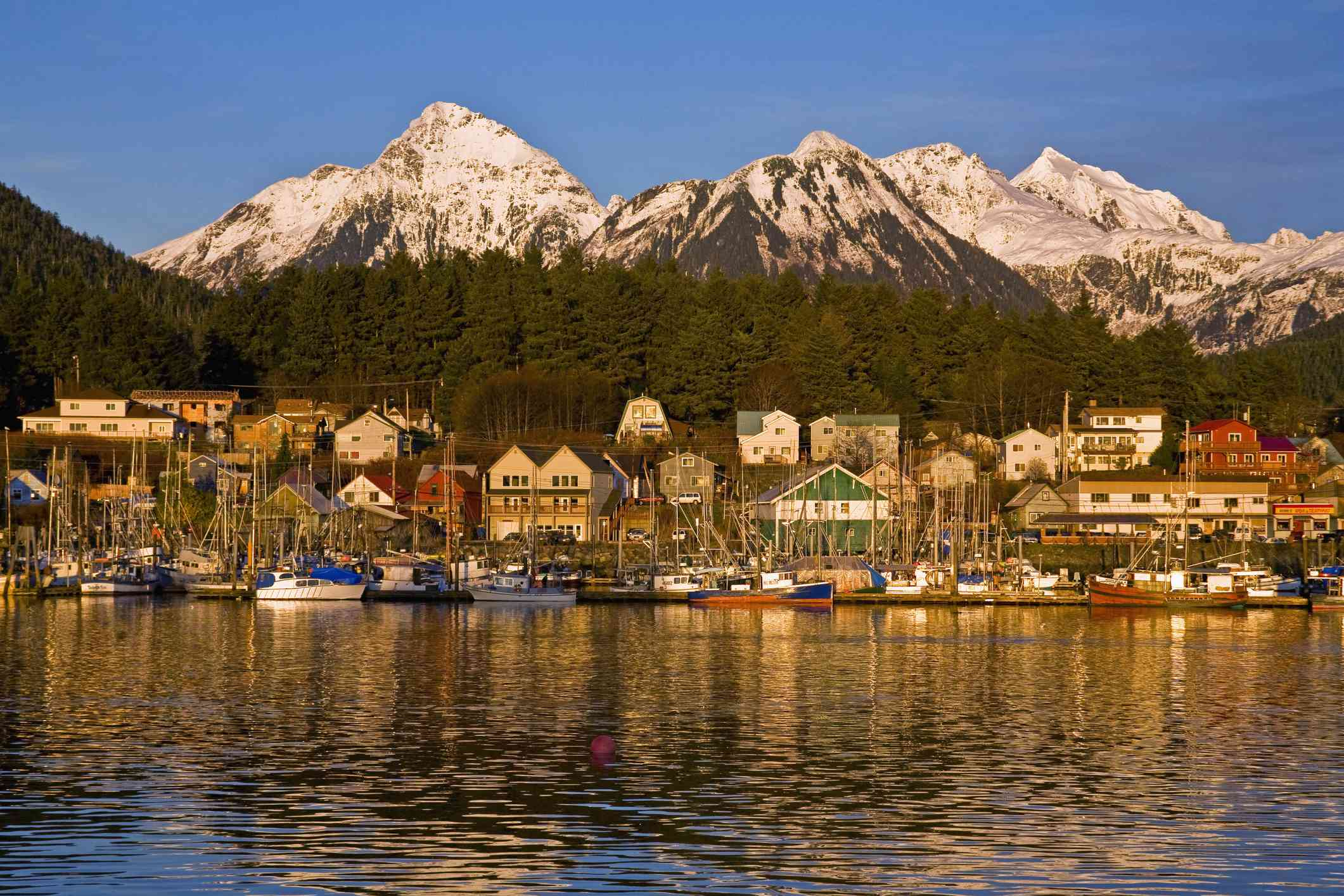 Downtown Sitka and small boat harbor with Arrowhead Peak in the background
