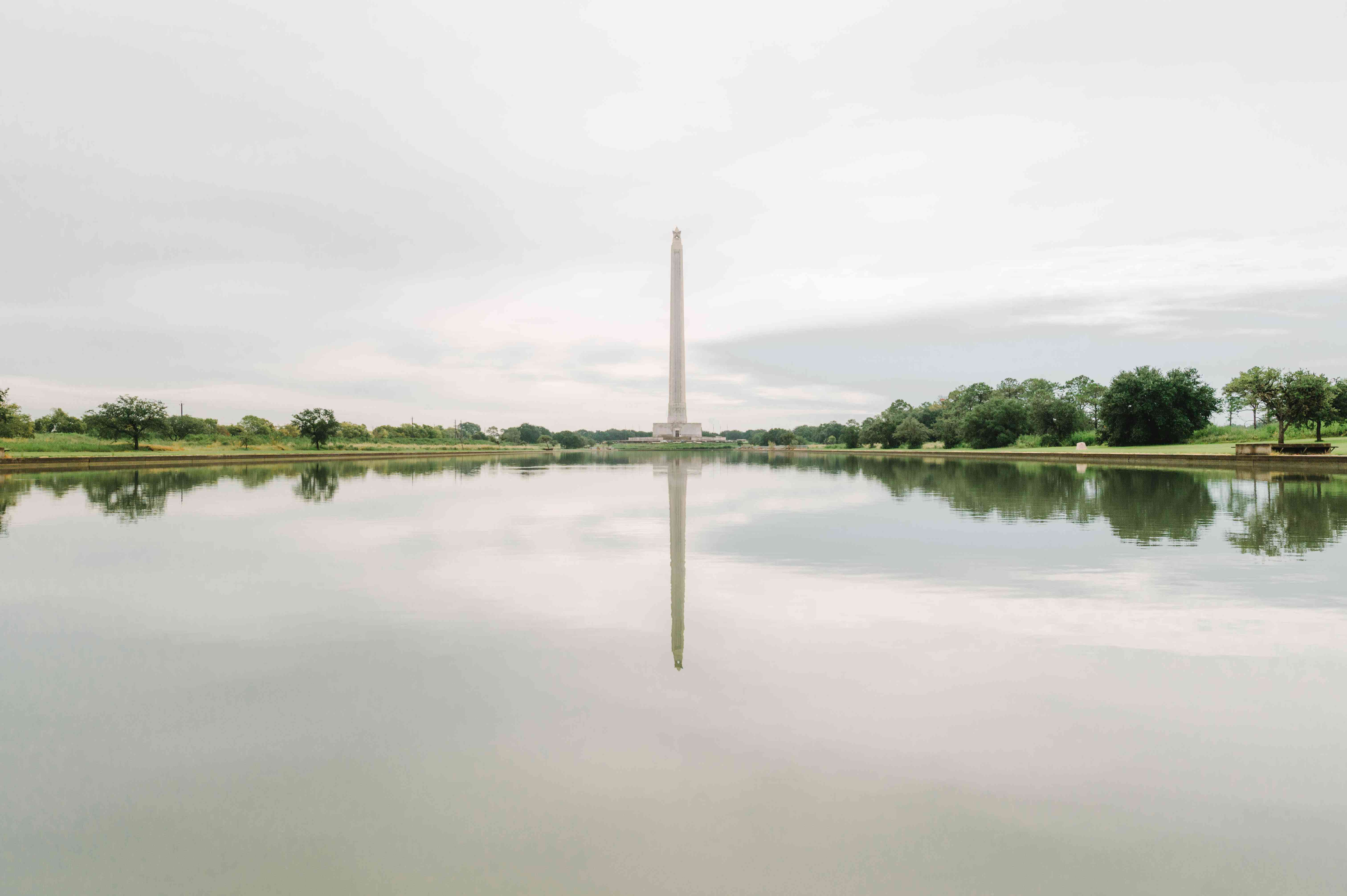 View of San Jacinto monument from across the pond that is reflecting the tower