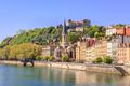 Buildings By River in Lyon Against a Clear Blue Sky