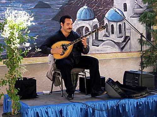 Petros C. Anagnostakis plays a Greek bouzouki.
