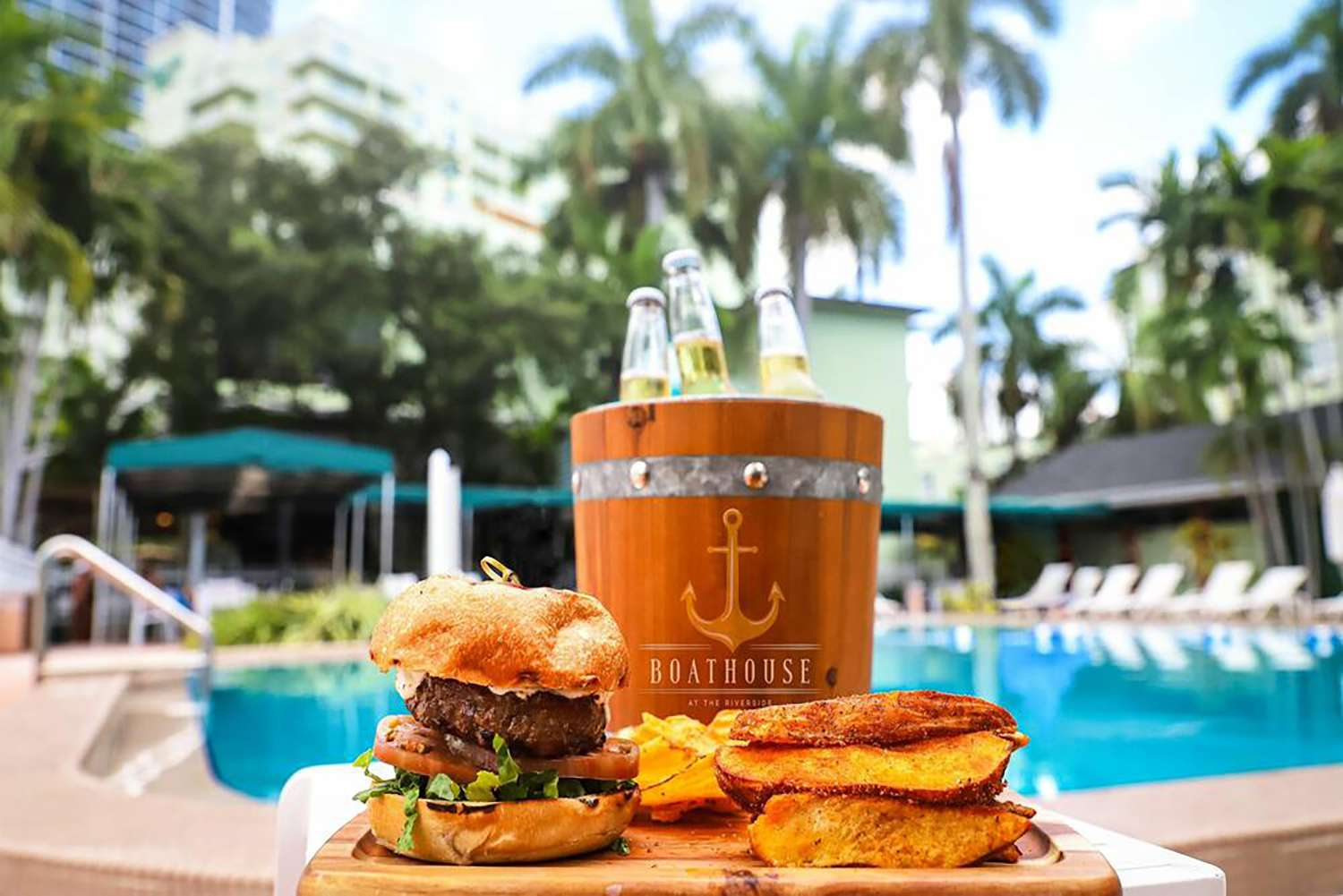 Burgers and food poolside at Boathouse at the Riverside in Fort Lauderdale