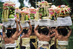Offerings being carried to Bali temple, Indonesia