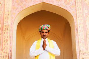 Indian man demonstrating Namaste prayer hands