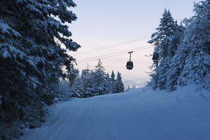 Ski gondolas ascending the slopes, Killington Ski Resort.