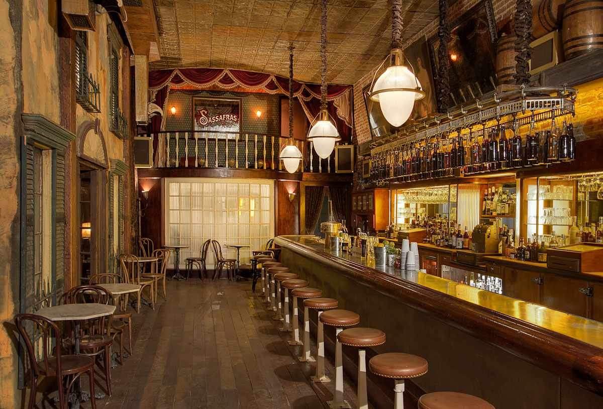 Saloon-decorated bar with brown stools and a long wooden bar