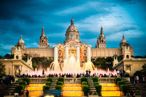 'Tourists watching colorful fountain Font MA gica show at Montjuic MNAC. Barcelona, Catalonia, Spain.'