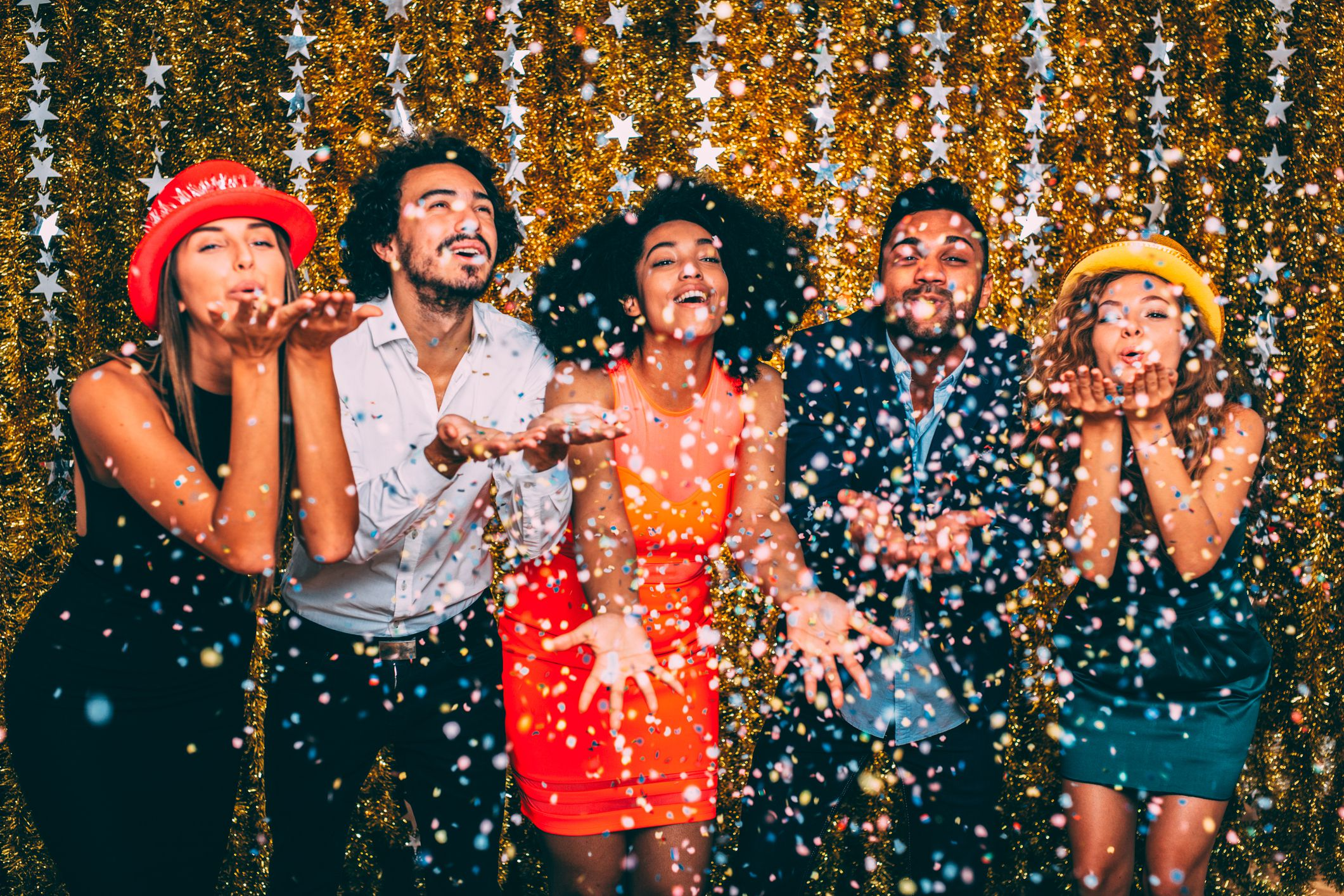 A group of young adults celebrate New Year's Eve
