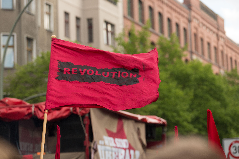 Germany, Berlin, Kreuzberg, red flag on demonstation on 1st of May