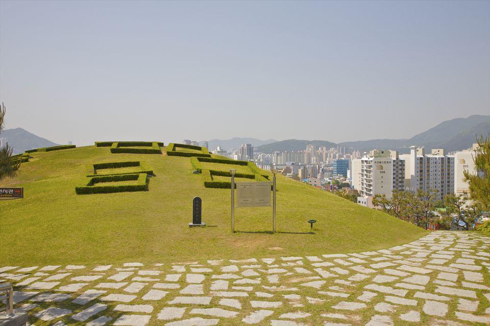 Outdoor museum on hillside atop city