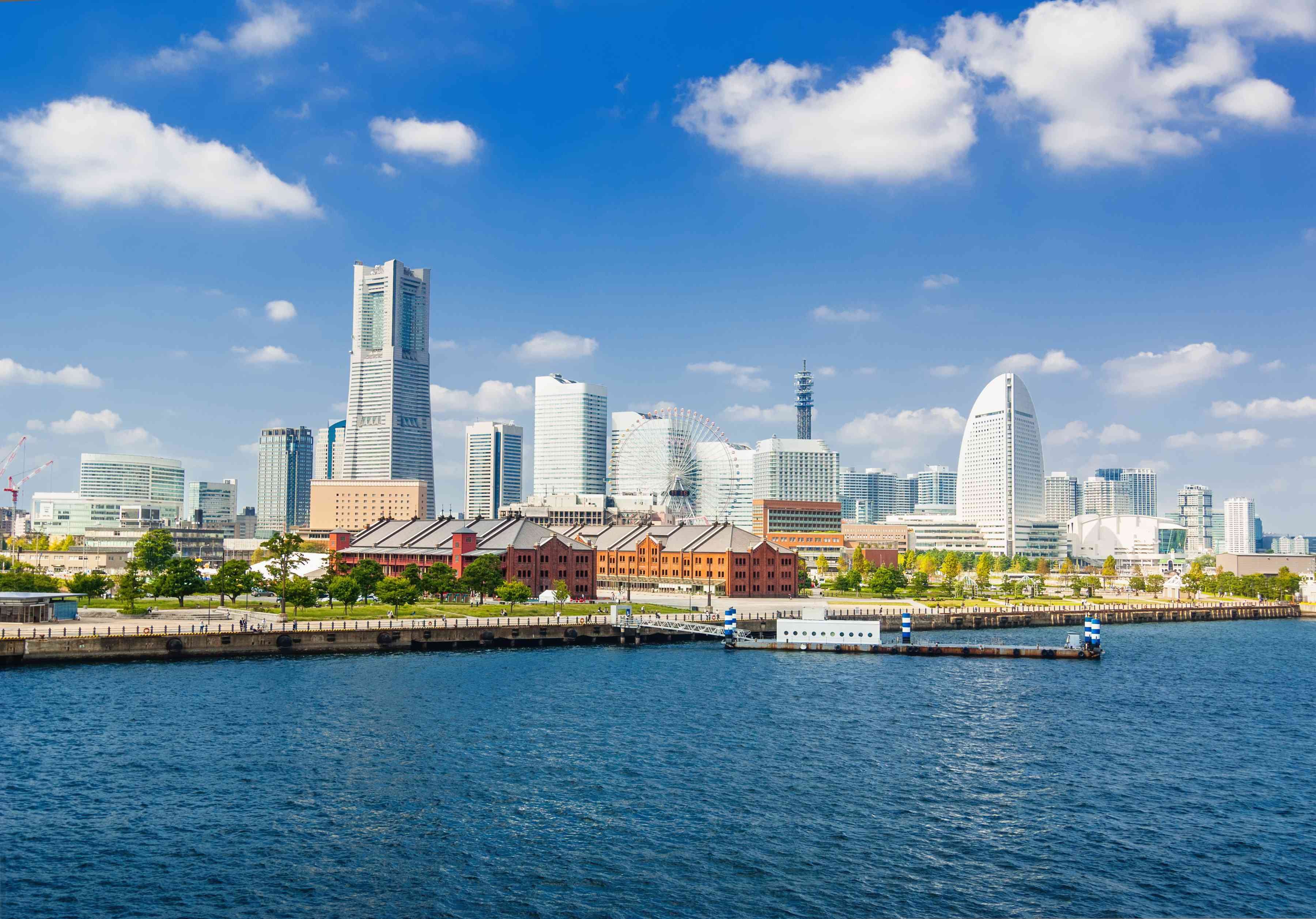 The skyline of Yokohama with the Landmark Tower, Queen's Square and the ferries wheel with the Aka-Rengo Soko warehouse