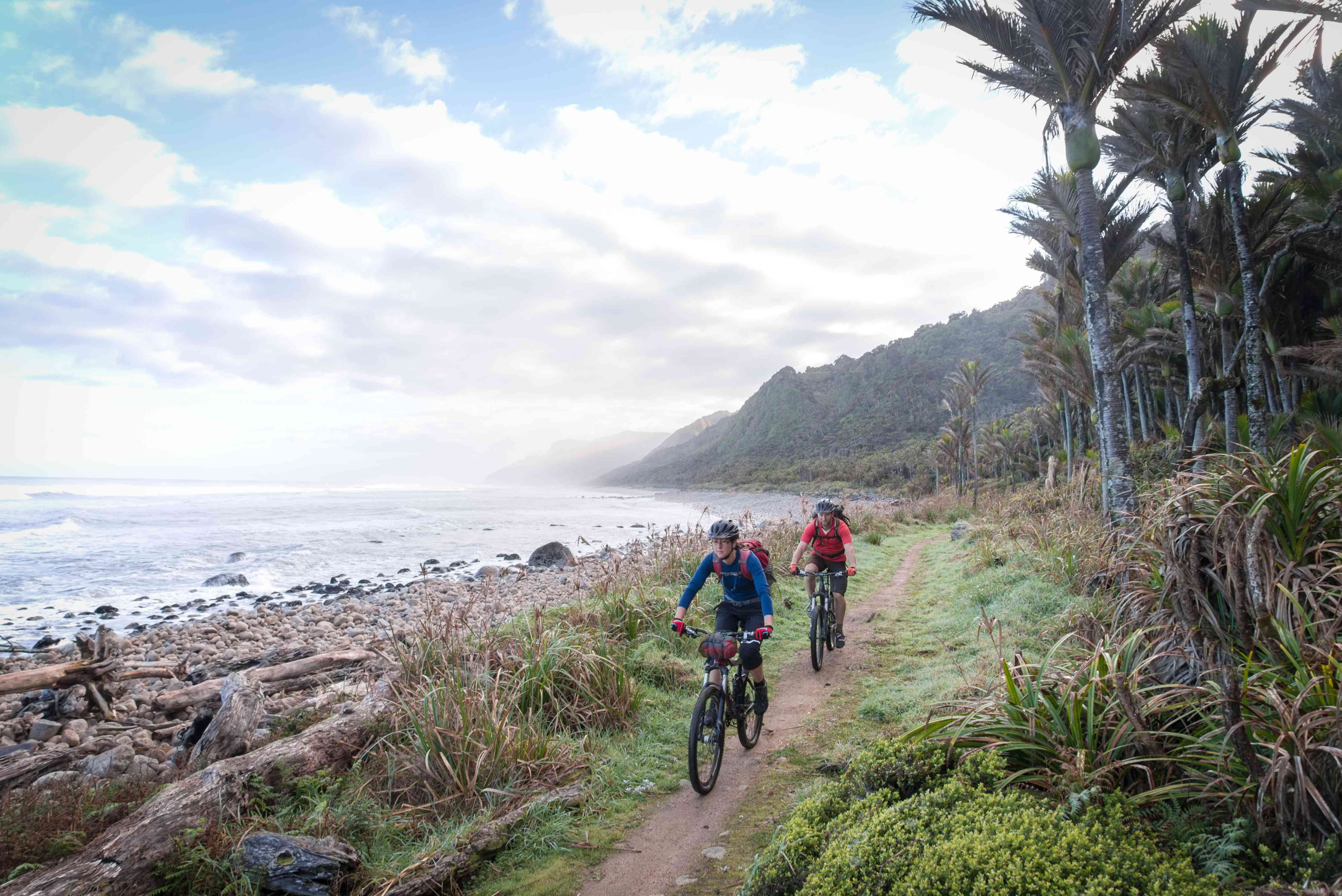 Coastal cycling on Heaphy Track near Karamea, New Zealand