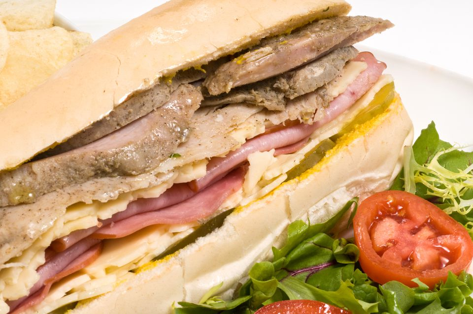 A Cuban sandwich is a variation of a ham and cheese and is made with ham, roasted pork, Swiss cheese, pickles, mustard, and sometimes salamion Cuban bread.