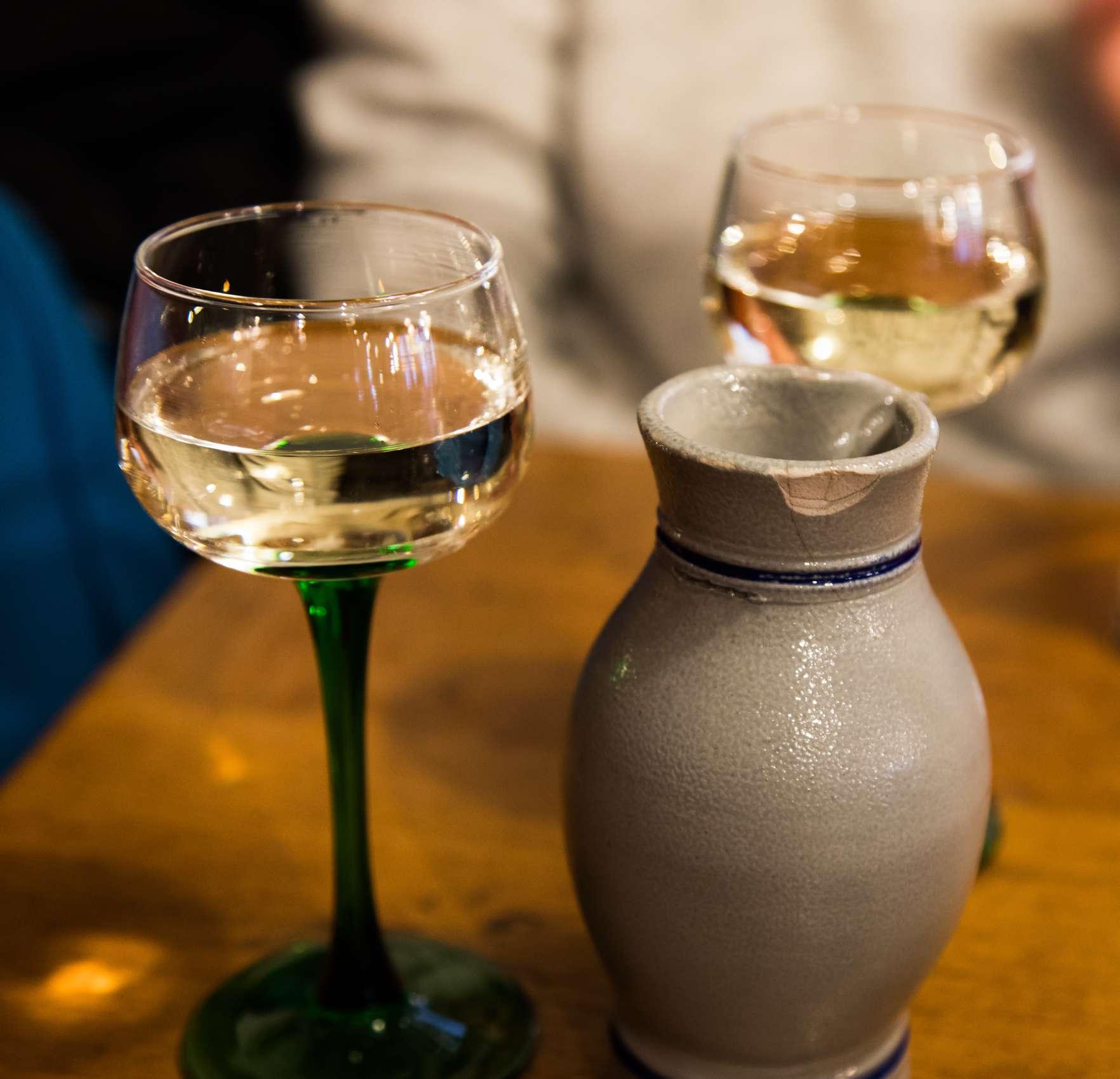 White wine in traditional Alsatian-style wine glasses