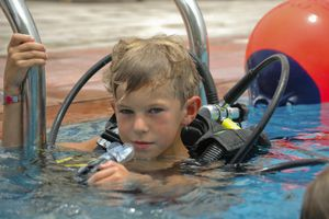 Boy learning to scuba dive