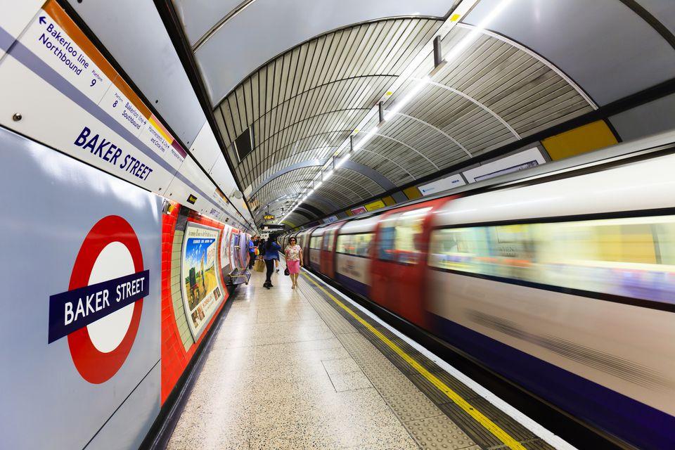 A train speeds through the London Underground